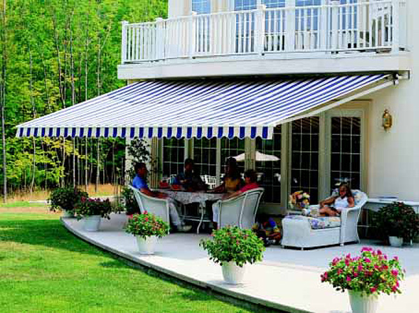 retractable awning cooling a home