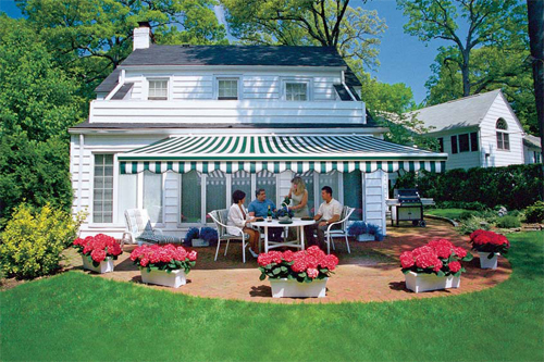 Summertime dining in the shade of a retractable awning