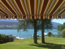 Add appeal to your lakefront property with retractable awnings